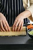 Rolling up maki sushi