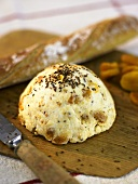 Spicy soft cheese with caraway seeds