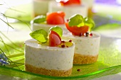 Garlic cheesecakes garnished with basil and tomato