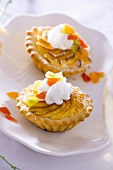 Cheese tarts topped with cream and candied fruit