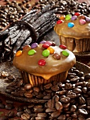 Coffee & vanilla muffins decorated with coloured chocolate beans