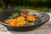 Marigolds in a dish of water