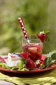 Strawberry punch, fresh strawberries and petit four