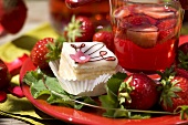 Petit four, fresh strawberries and strawberry punch