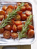 Cocktail tomatoes with rosemary in aluminium roasting dish