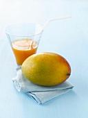 Mango with mango juice and napkin