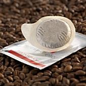 Espresso pod on coffee beans
