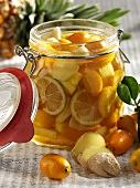 Fruit preserved in rum (kumquats & pineapple) with ginger