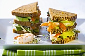 Club sandwich with prawns, pears and avocado