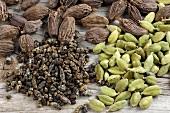 Brown and green cardamom pods and cardamom seeds