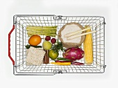 Various foods in shopping basket (from above)
