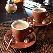 Two cups of espresso in a café setting