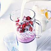 Making a berry milkshake: adding the milk