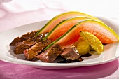 Roast duck breast with apple, melon and Calvados sauce