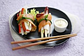 Smoked salmon rolls filled with vegetables and surimi