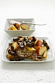 Pork with dried figs and apple wedges