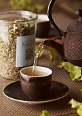 Pouring herb tea