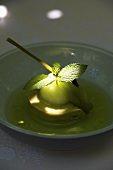 Apple sorbet with mint leaf