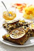 Home-made muesli slices with orange marmalade