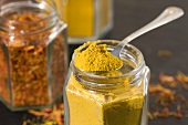 Curry powder and saffron in jars