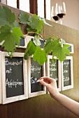 Hand writing menu on blackboard in a wine bar