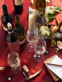 Wine bottles, wine glasses and notepad at a wine tasting