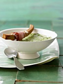 Watercress soup with crispy ham roll