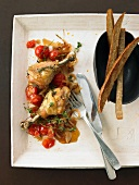 Roast chicken legs with cherry tomatoes & strips of bread