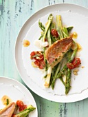 Red mullet on green asparagus and Taleggio cheese