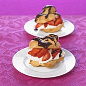 Choux pastry case with strawberries, cream & chocolate sauce