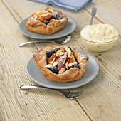 Peach wedges and blueberries in puff pastry shells