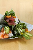 Temaki sushi with salmon, tuna and vegetables