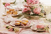 Rose pudding, madeleines & rose waffles on decorated table