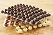 Chocolate truffle shells (white, milk and dark)