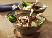 Noodle soup with lamb skewers