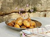 Loukoumades (Greek honey balls with sesame seeds)