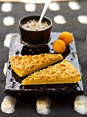 Pine nut tart with apricot sauce