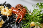 Black spaghetti with seafood and herbs