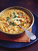 Yellow pea soup with pancetta, parsley and cheese