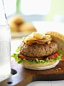 Chicken burger with caramelised onions