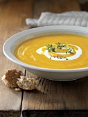 Pumpkin cream soup with yoghurt and thyme