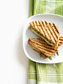 Green asparagus, ham and cheese in toasted sandwich