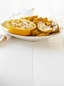 Potato wedges and yoghurt dip with caramelised onions
