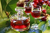 Cherry liqueur in decanter and glasses