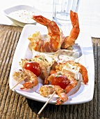 Grilled prawn and feta kebabs and bacon-wrapped prawns