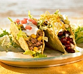 Taco shells filled with mince and with beans