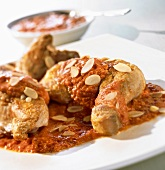 Chicken in red almond sauce