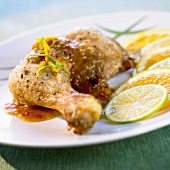 Cuban chicken with orange and lime slices