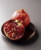 Half a pomegranate and a whole pomegranate