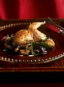 Quail with walnut-stuffed prunes and spicy grape sauce